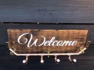 """Welcome"" unique copper pipe coat rack."