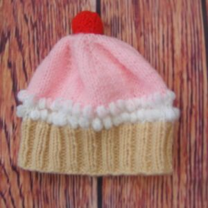Hand Knitted Cherry Cupcake Hat with pink icing and red cherry for a baby girl 0-3 Months