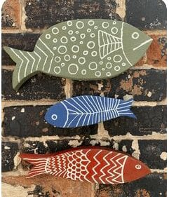 Red, green and blue reclaimed wooden hanging fish