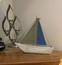 Little green and blue wooden boat