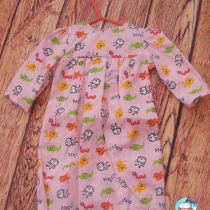 Cotton nightie for a baby 0-3 months. 10% of all sales goes to breast cancer and honeybee research.