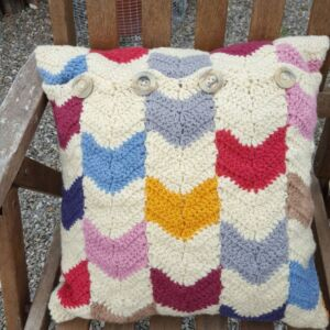Cushion cover with colourful chevron shapes