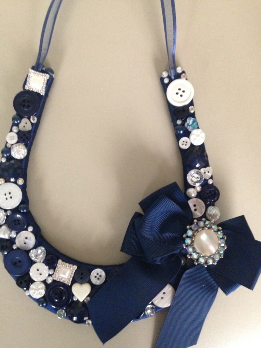Hand decorated horseshoes made with vintage and modern buttons and sparkle