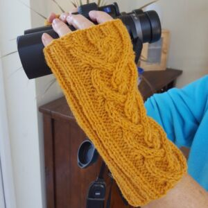 Woollen fingerless mitts with heart shaped cable pattern