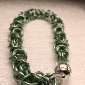 Bracelet in rich Green with silver plated magnetic cach for ease of fastening. Complex Byzantine weave is used to create this lovely bracelet. An ideal and unique gift.