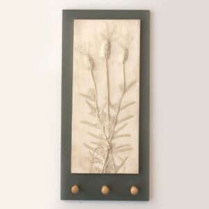 floral art casting of lavender on charcoal grey back board with three shaker wooden pegs