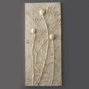 Plaster wall tile casting of wild daisy flowers
