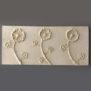 Plaster wall tile casting of wild ivy flowers