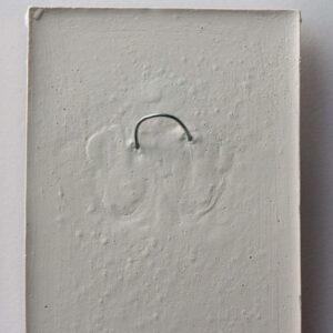 Plaster wall plaque hanging loop
