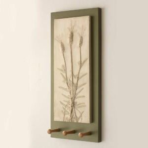 floral art casting of lavender on back board with three shaker wooden pegs