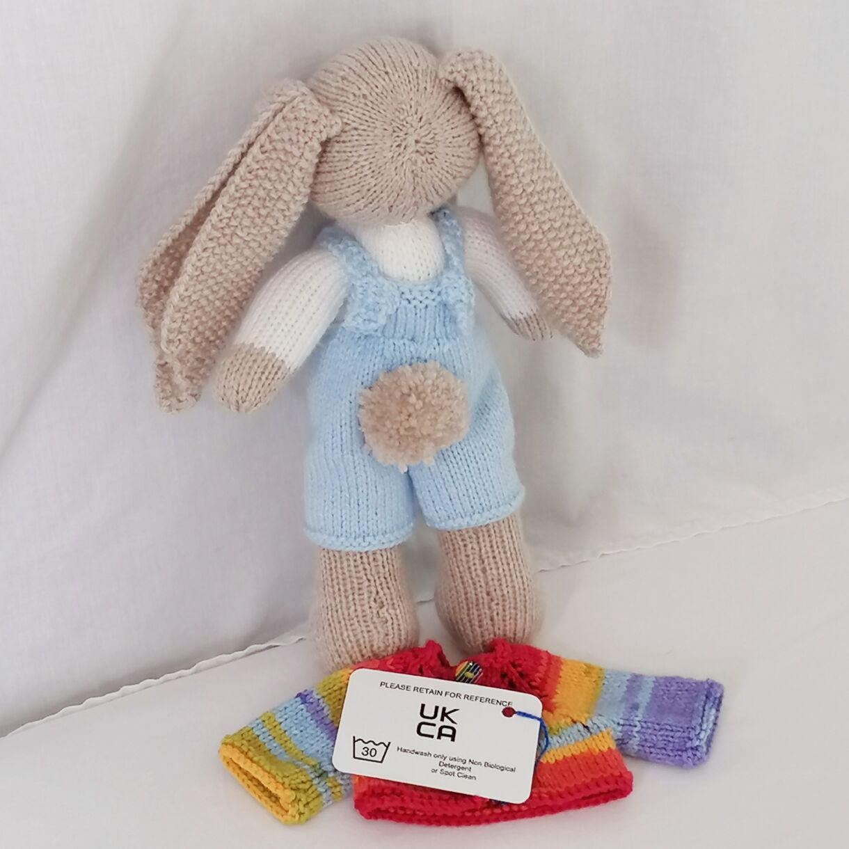 handknitted-rainbow-bunny-unique-gift-blue-back-no-jacket