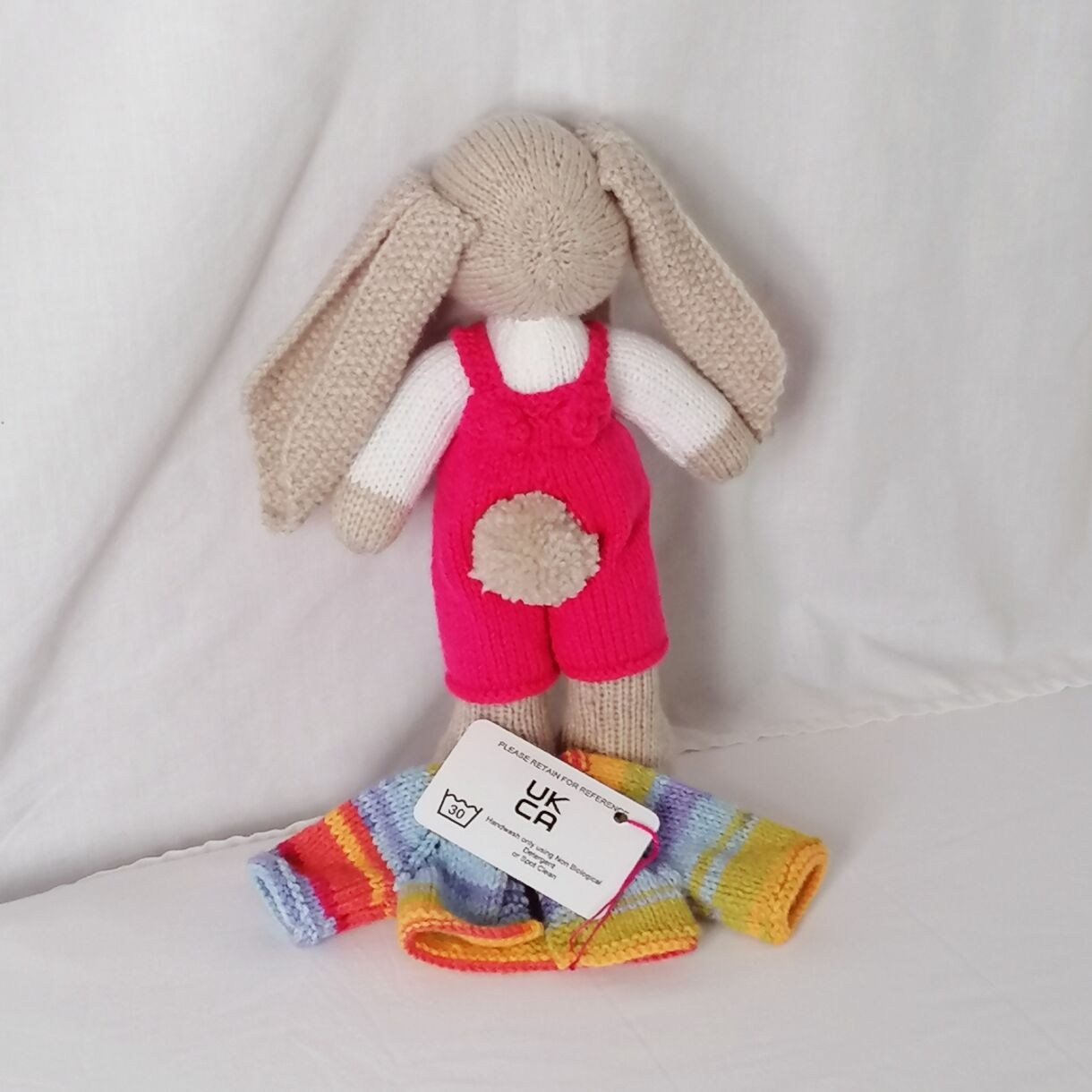 handknitted-rainbow-bunny-unique-gift-pink-back-no-jacket