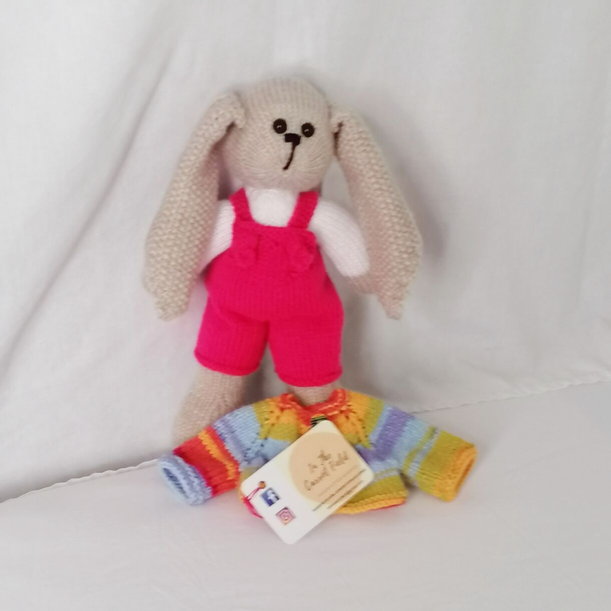 handknitted-rainbow-bunny-unique-gift-pink-front-no-jacket