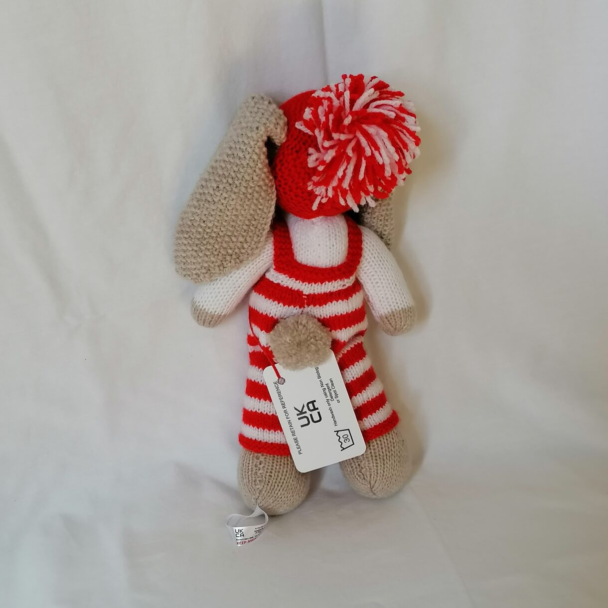 Hand-knitted-soft-toy-Christmas-bunny-red-white-hat-pompom-back